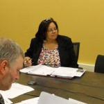 Ms. Jamison at work in a Legal Aid board meeting.